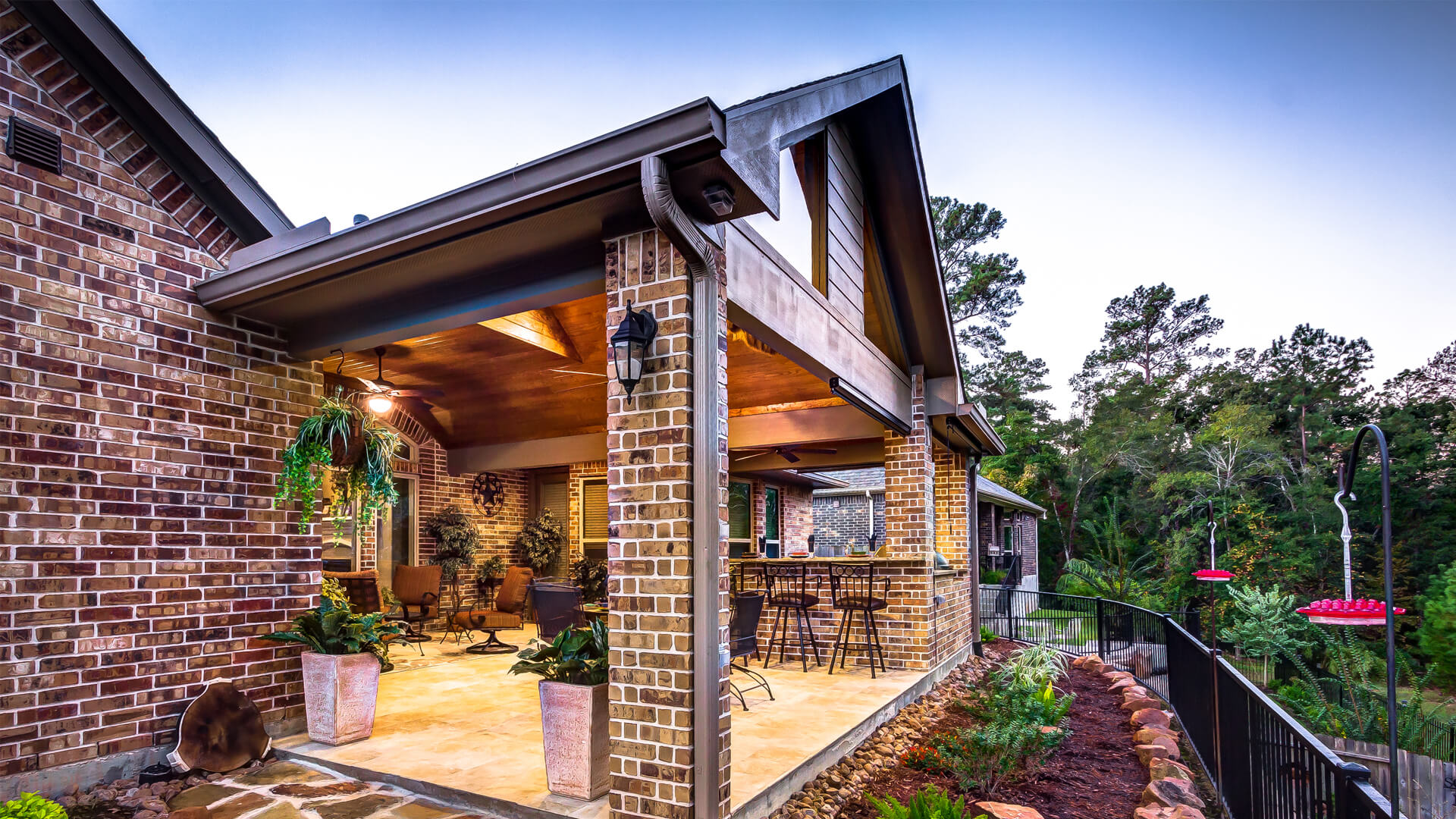 Attached Custom Covered Patio with Summer Kitchen by Creekstone Outdoor Living
