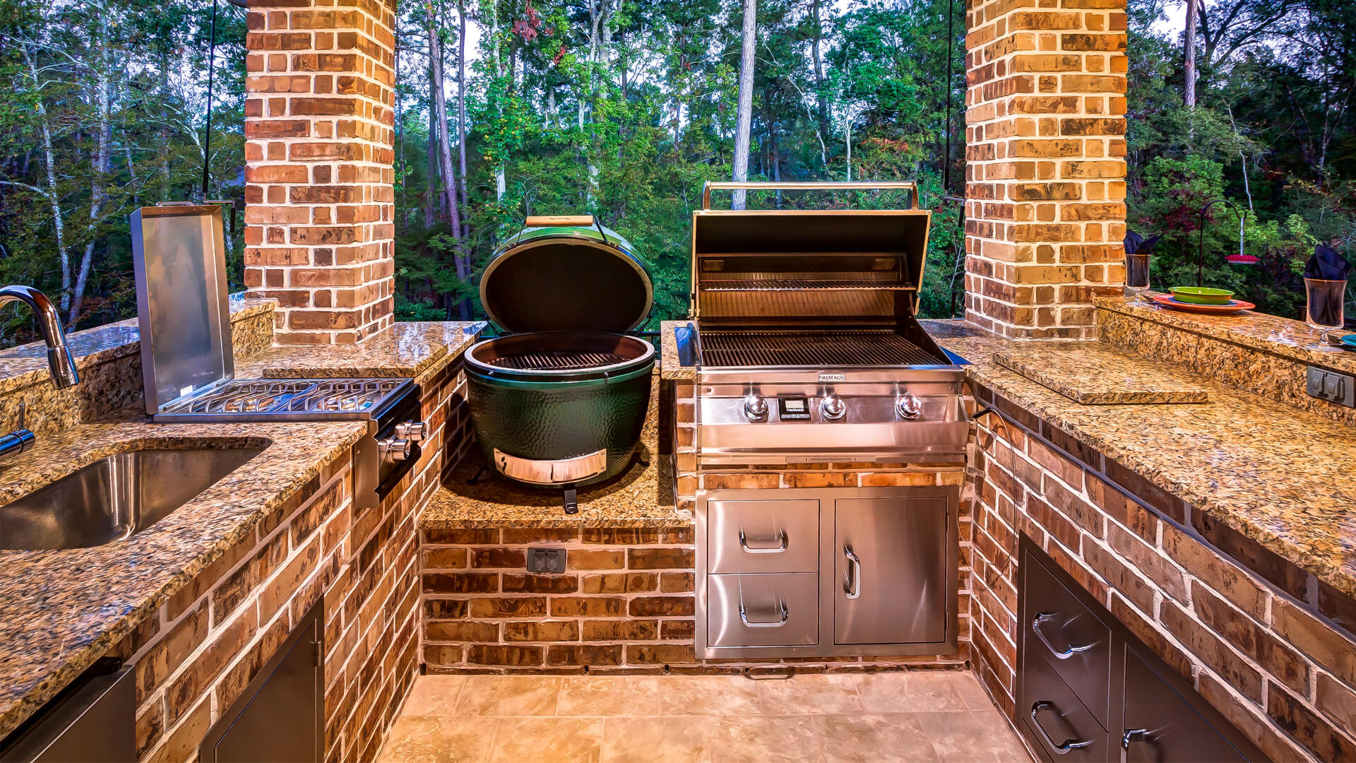 Covered Patio with Summer Kitchen by Creekstone Outdoor Living