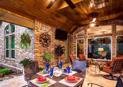 Outdoor Kitchen with dinning area and living room