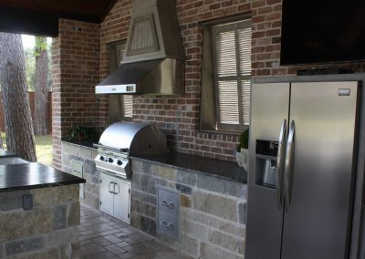 A Full Outdoor Kitchen and full size Refrigerator in Hoston