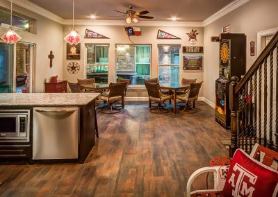 Custom Kitchen and Dining Area in a Houston Pool House