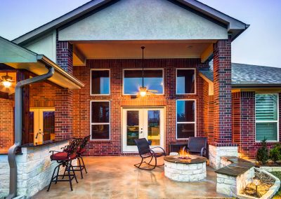Attached Patio Cover with Outdoor Kitchen and Fire Pit in Houston