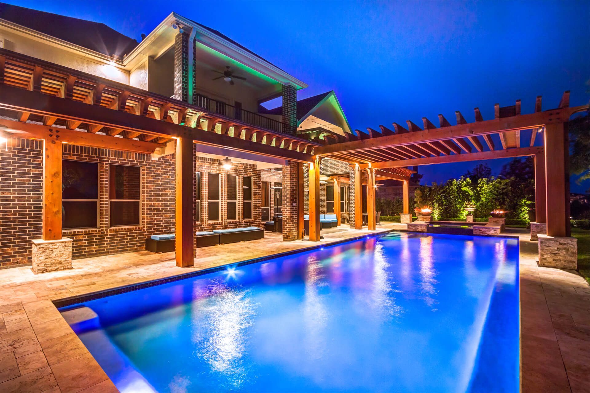 Custom Cedar Pergola over Pool with Living Space and Outdoor Kitchen in Houston, Texas