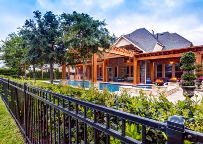 Poolside Summer Kitchen with Cedar Pergola by Creekstone Outdoor Living in Houston, Texas