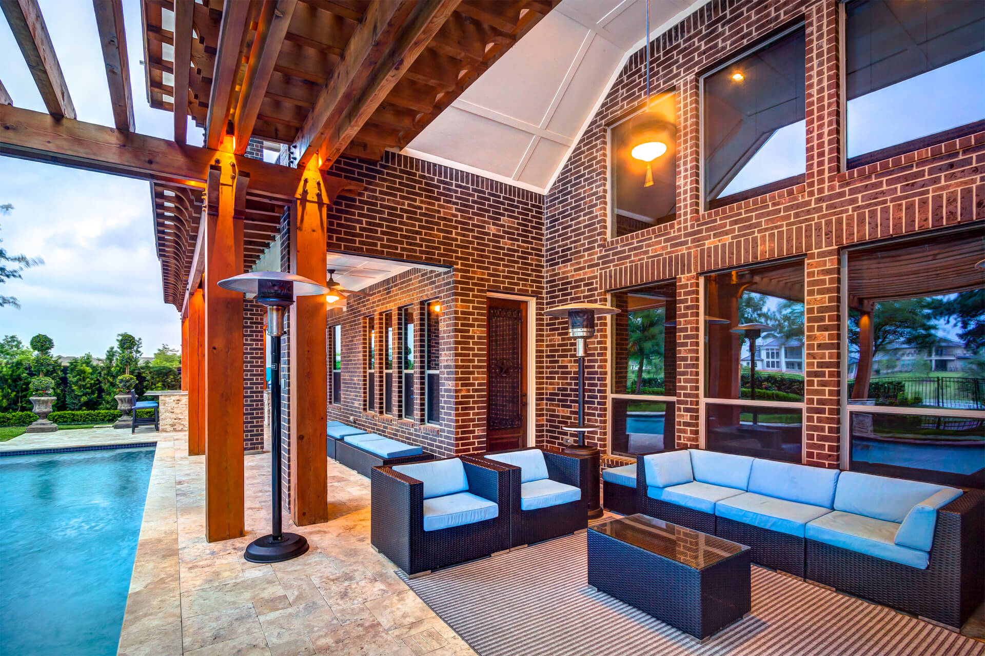 Outdoor Living Space with Cedar Pergola by Creekstone Outdoor Living in Spring, Texas
