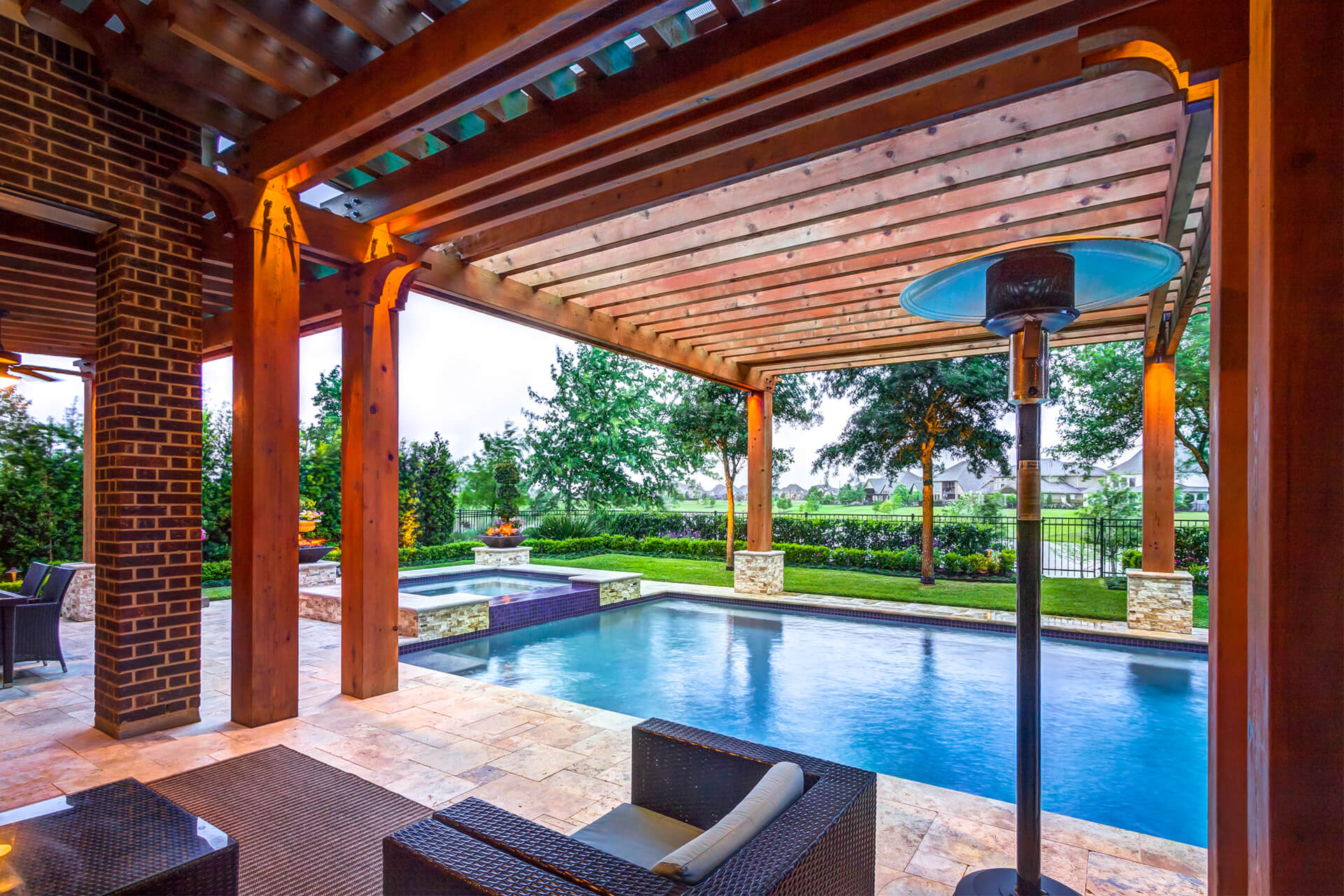 Custom Pergola over Pool with Outdoor Living Space - by Creekstone Outdoor Living