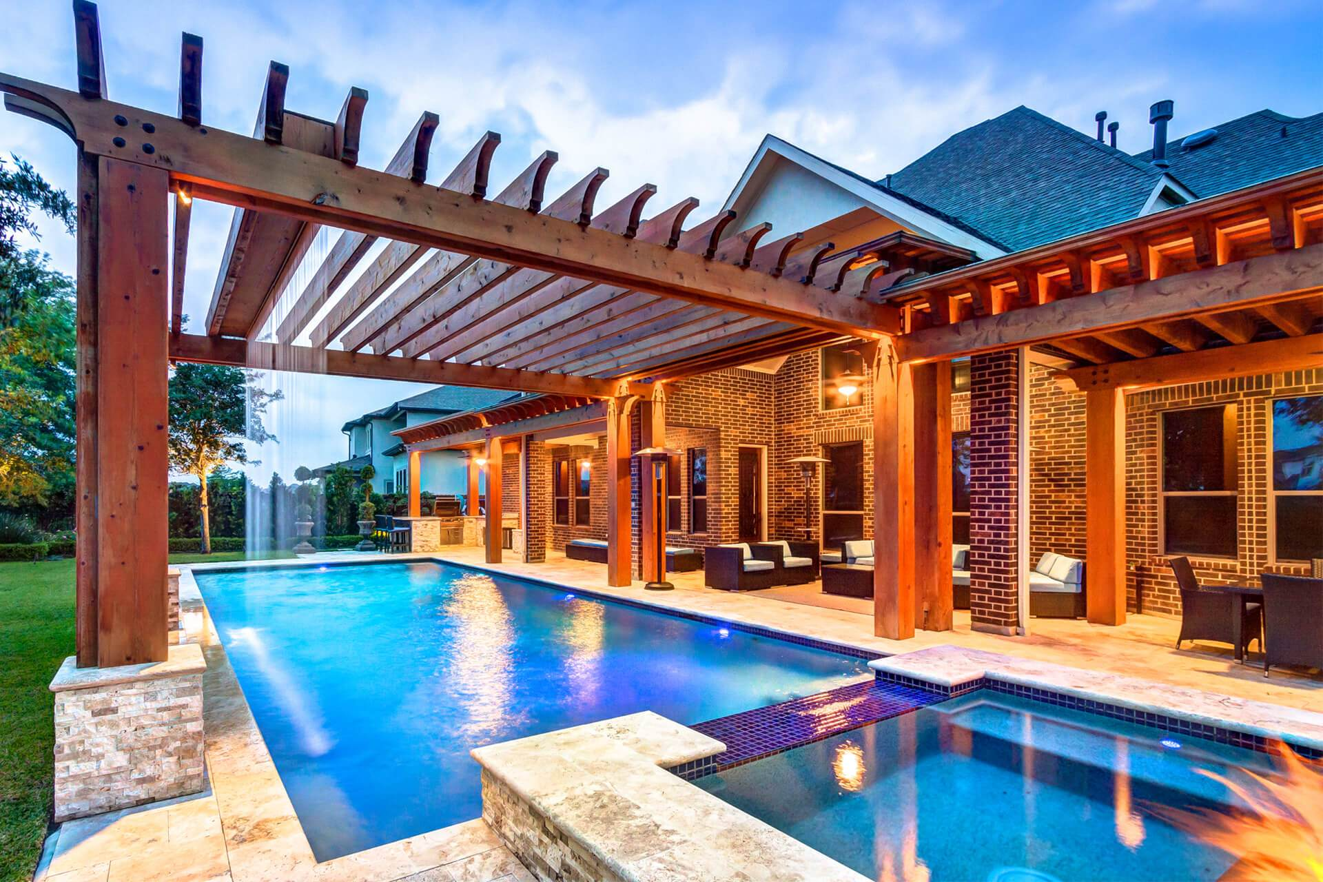 Custom Pergola with Waterfall Accent in Houston Texas by Creekstone Outdoor Living